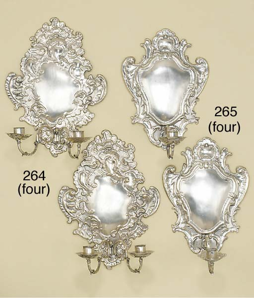 A set of four silvered repouss