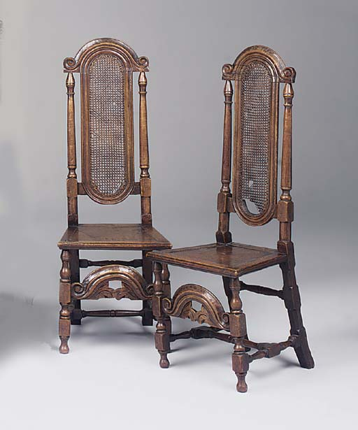 A pair of oak highback chairs,