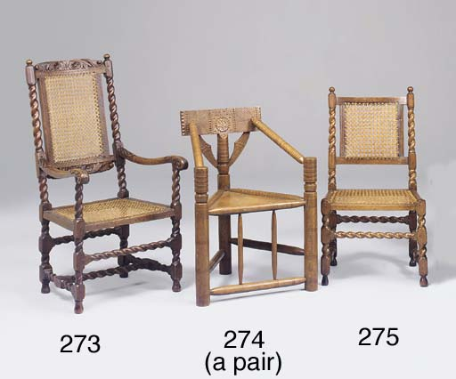A walnut and caned side chair,