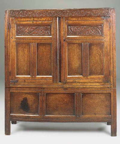 AN OAK PANELLED PRESS CUPBOARD