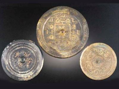 Three circular bronze mirrrors