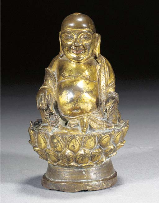 A gilt-bronze model of Budai 1