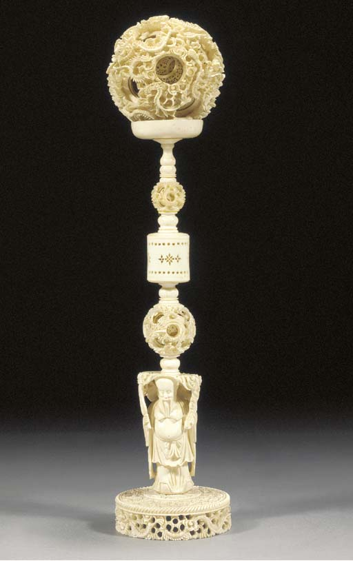 A carved ivory puzzle-ball and