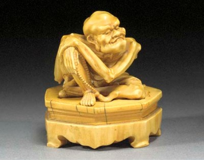An ivory carving of an emaciat