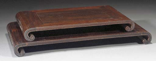 Two hardwood scroll shaped sta