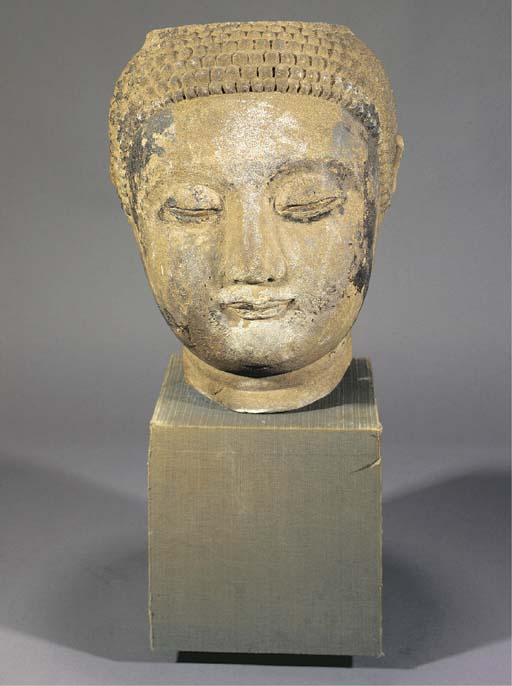 A large stone Buddha head 16/17th Century