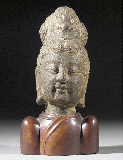 A stone head of Guanyin Yuan/Early Ming