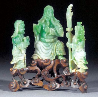 A jadeite group of three figur