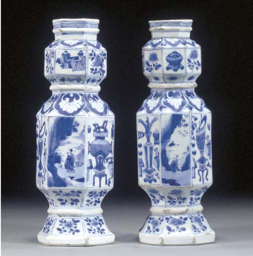 Two similar blue and white vas