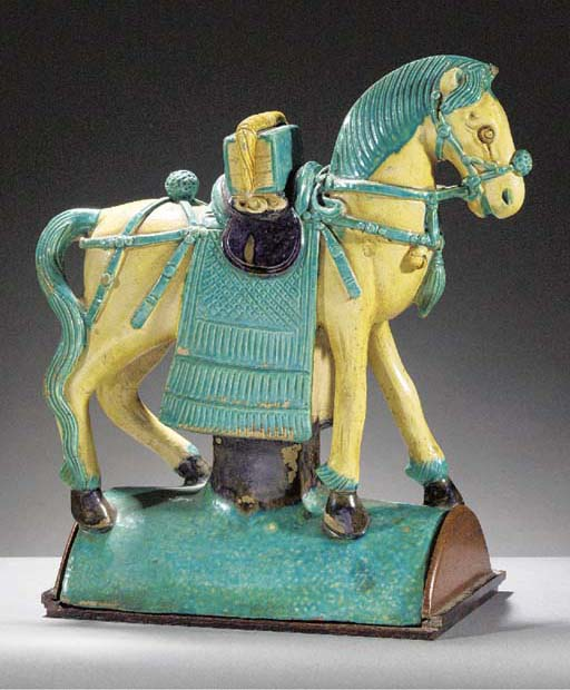 A turquoise, yellow and auberg