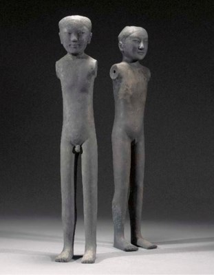 A pair of grey pottery stick f