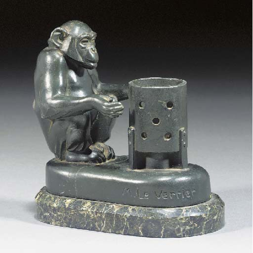 A GREEN PATINATED SPELTER FIGU