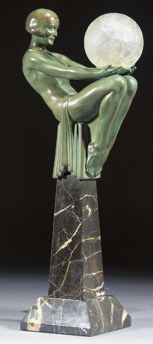 A GREEN PATINATED SPELTER LAMP