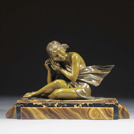 A GREEN PATINATED BRONZE FIGUR