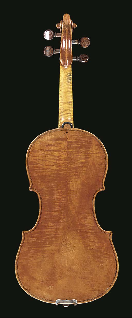 An interesting violin, Venetian School, labelled Sanctus Seraphin, Utinensis fecit Venetijs Ann. 1720, the two-piece back, cut on the slab, of medium to narrow curl, the ribs and head similar, the table of even medium grain, the length of back 14in. (355mm), in case	 (2)