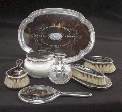 A Five Piece Silver-Mounted To