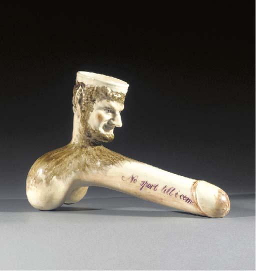 A pottery erotic novelty stirr