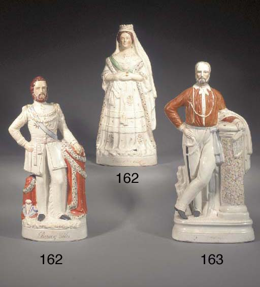 A pair of figures of Victoria