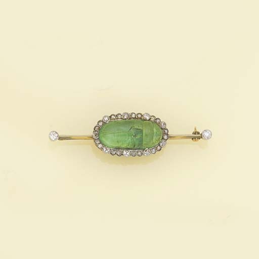 A diamond and carved emerald s