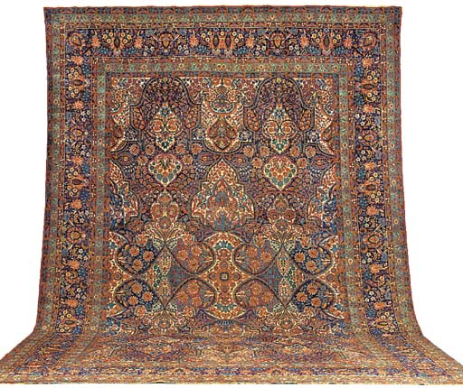 An antique Kirman Laver carpet