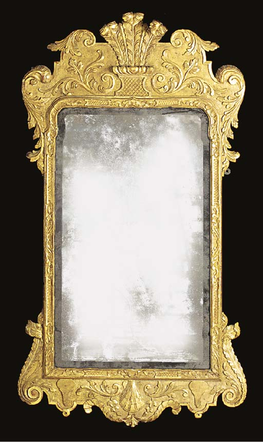 A CARVED GILTWOOD MIRROR, LATE