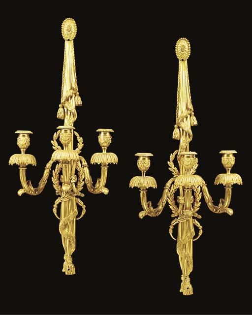 A pair of gilt metal three lig