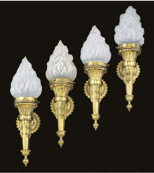 A set of four Edwardian brass