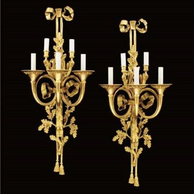 A pair of gilt bronze five lig