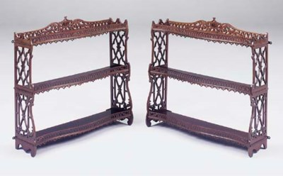 A PAIR OF FRET CARVED MAHOGANY