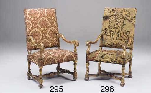 A carved giltwood upholstered
