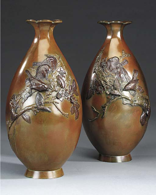 A pair of Japanese bronze ovif