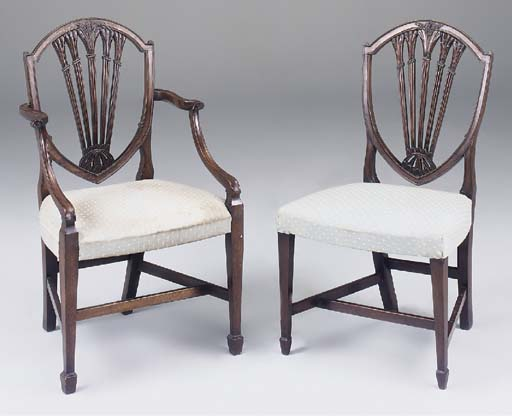 A set of eight carved mahogany