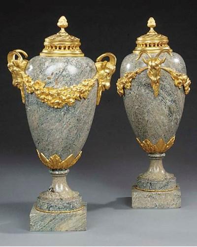 A pair of granite and gilt met