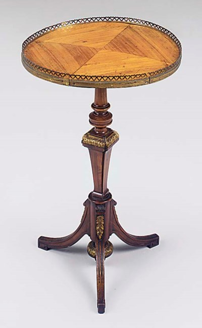 A tulipwood and walnut ormolu