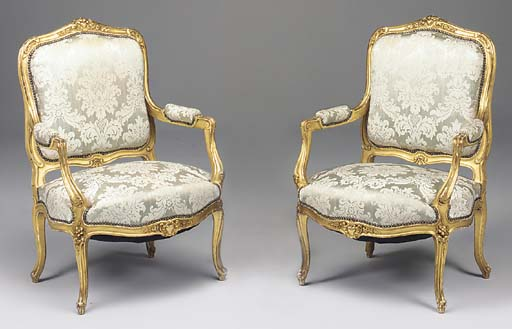 A pair of French carved giltwo