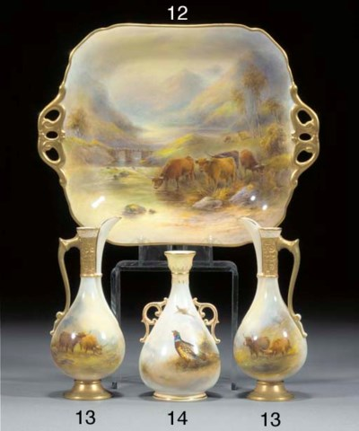A pair of Royal Worcester ewer