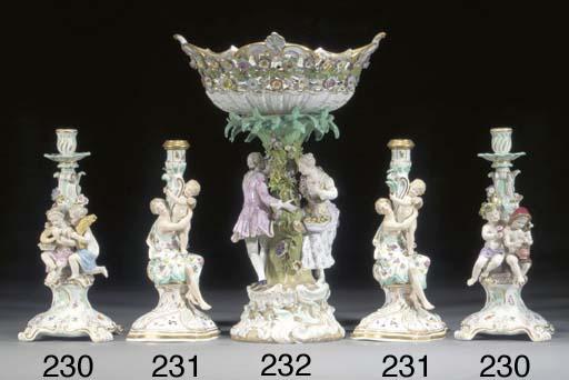 A pair of Meissen candlesticks