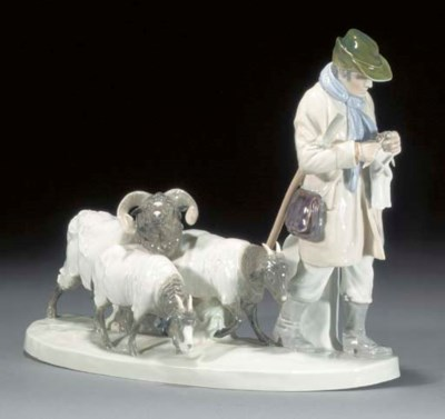 A Meissen group of a herder an