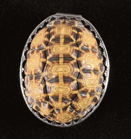 A silver-mounted turtleshell box