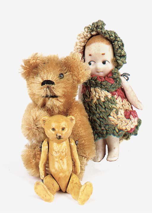 A miniature bisque teddy bear