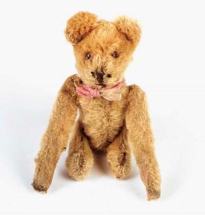 A Schuco tumbling teddy bear