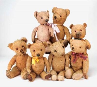 Seven bald British Teddy Bears