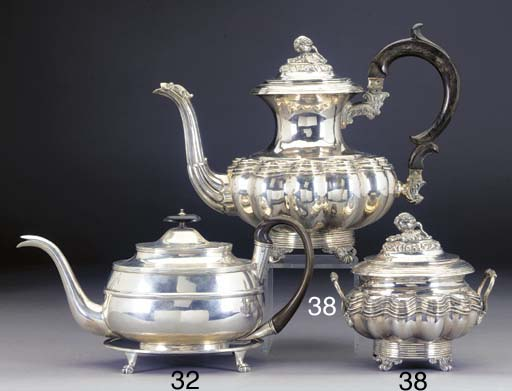 A 19TH CENTURY INDIAN COLONIAL SILVER TEAPOT AND STAND