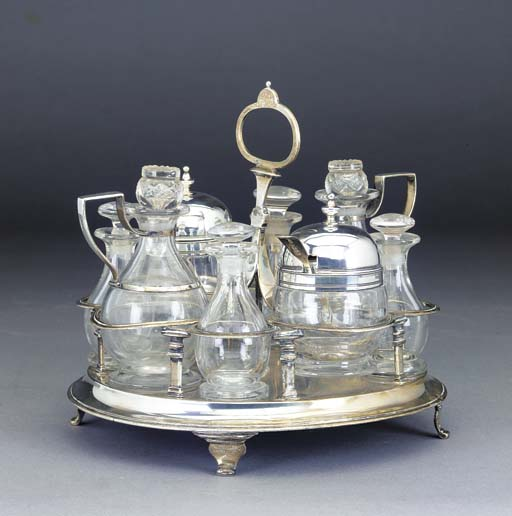 A GEORGE III SEVEN-BOTTLE SILVER AND GLASS CRUET