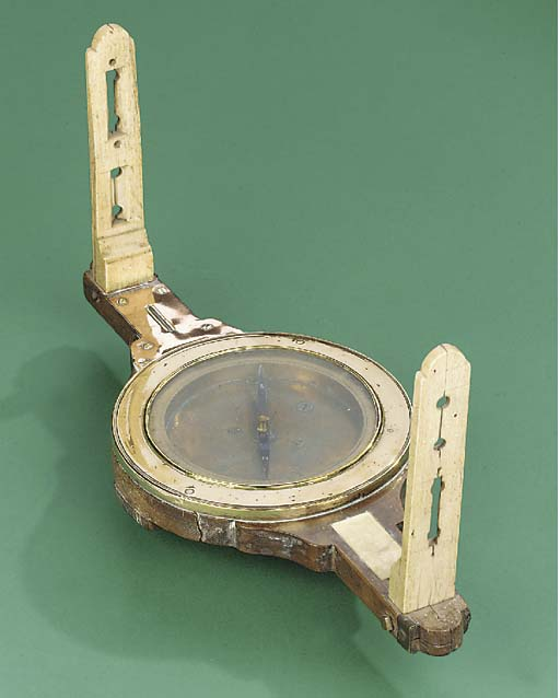 An unusual 19th-Century fruitwood and whalebone mining dial,