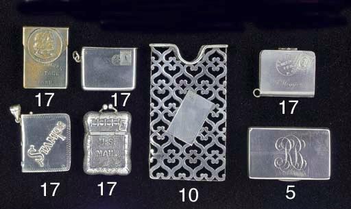 A silver stamp booklet holder