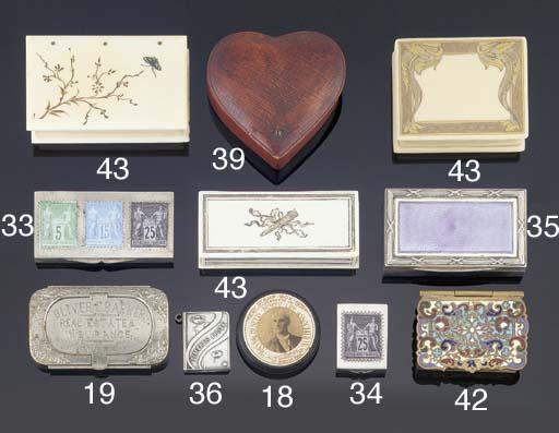 A bakelite stamp box