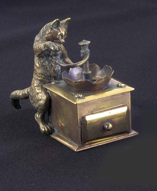 A brass figural stamp box