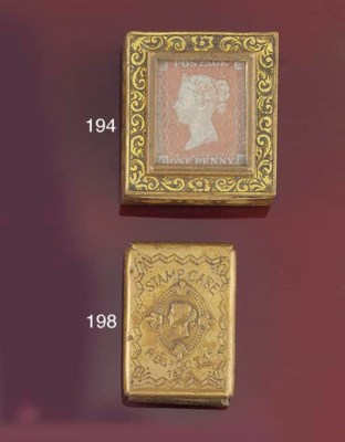A brass slide-action stamp cas