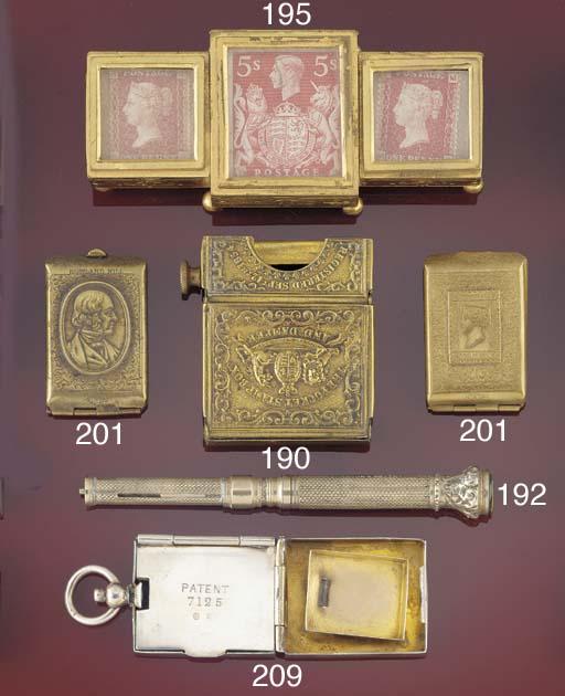 A brass stamp case
